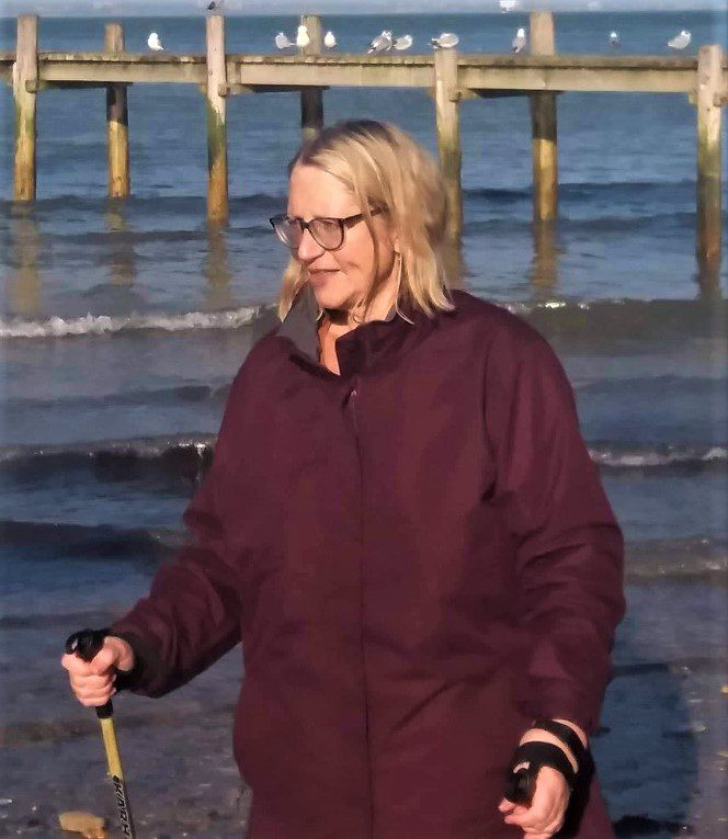 Moira walking on the beach