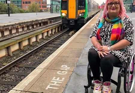 Picture of a lady in a wheelchair next to a railway track